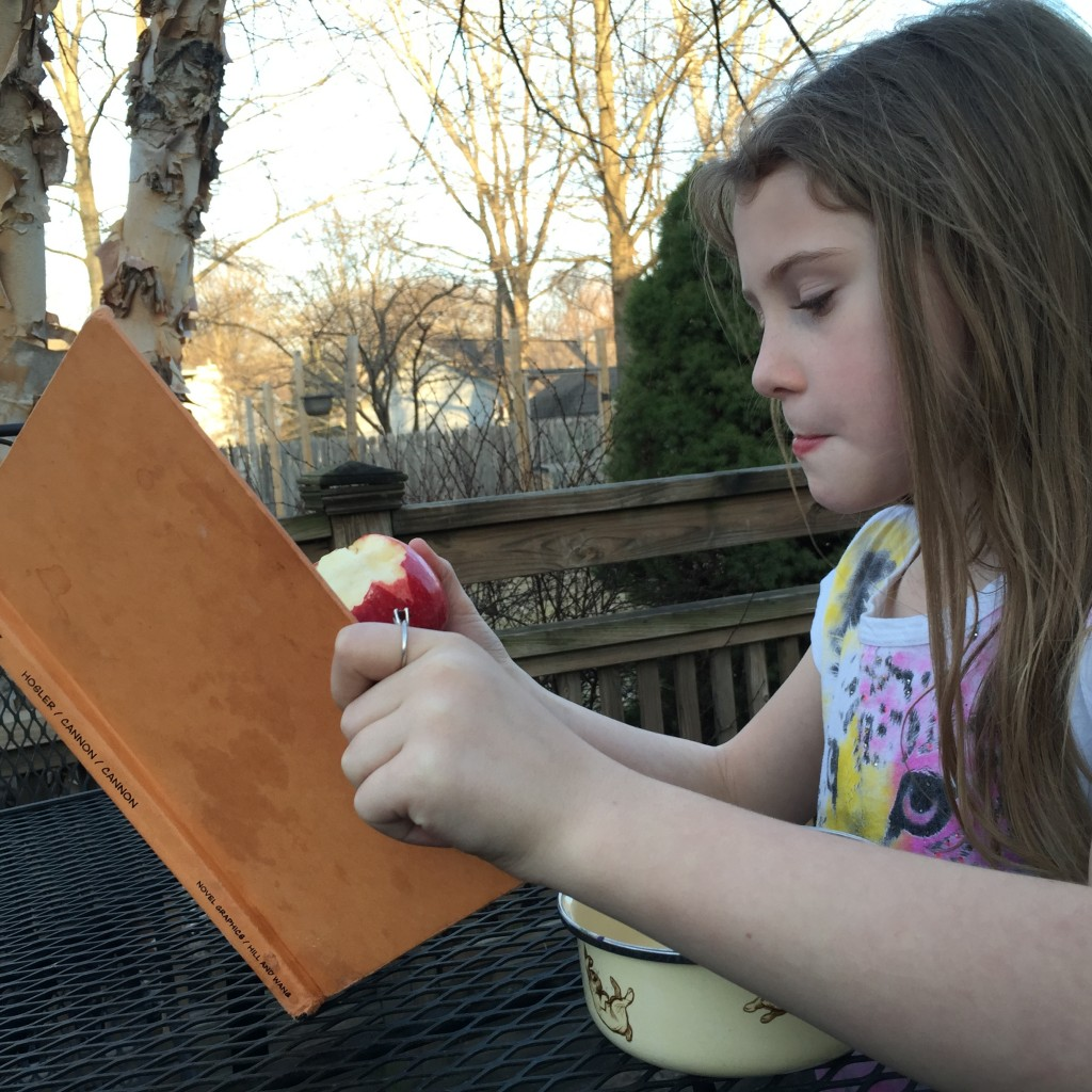 Delaney Reading with Apple